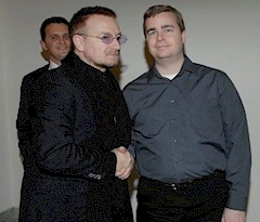 Rich Fisher with Bono in 2003