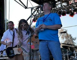 Rich Fisher introducing a band on stage in 2011